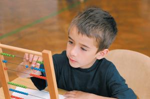 boy playing bead frame